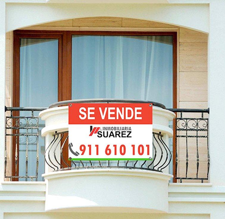 carteles inmobiliaria escaparate